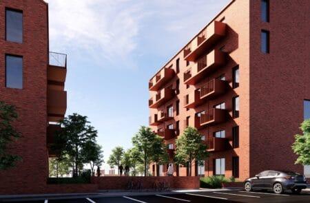 Seks- og fire-etagers boligblokke på vej ved Gudrunsvej